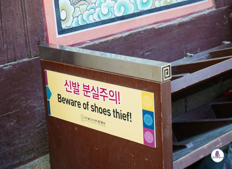 Shoes rack with warning sign about thieves! - Interesting facts about South Korea to Know before travelling there