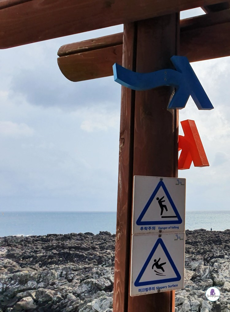 Wooden Arrows and safety signs on Jeju Olle Trails