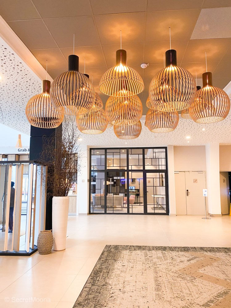 Entrance lobby of  Hilton Garden Inn Bordeaux Centre with hanging lamps