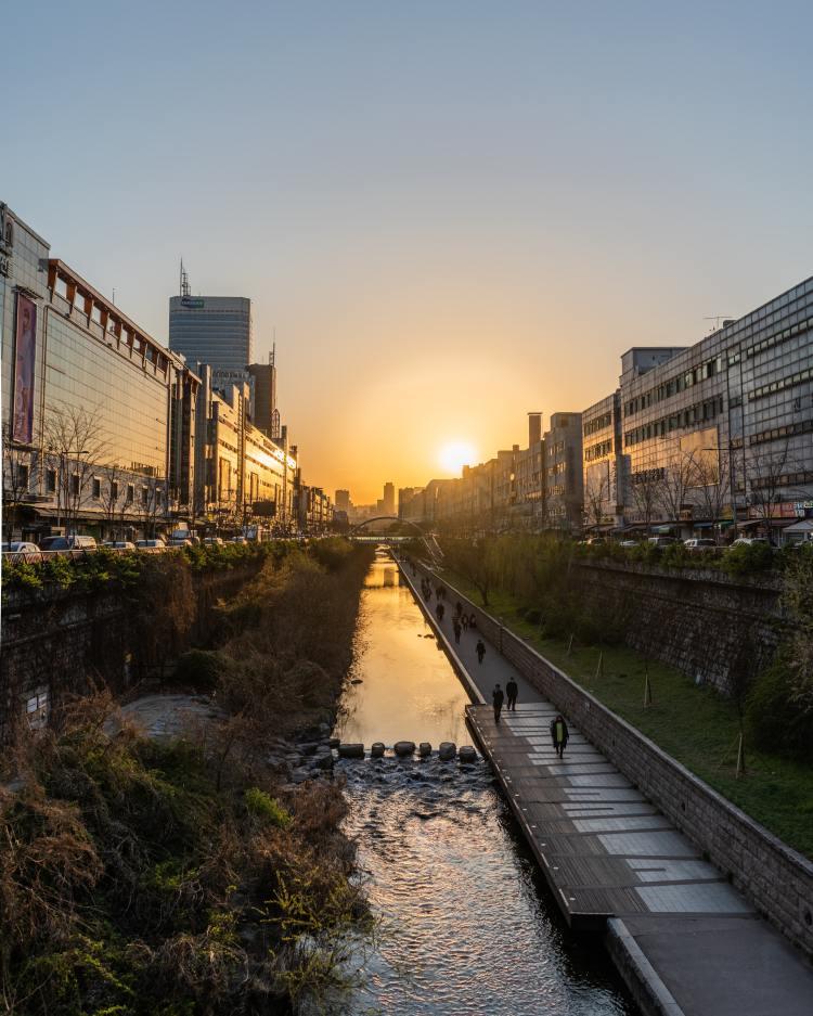 South Korea bucket list - People walking beside cheonggyecheon stream