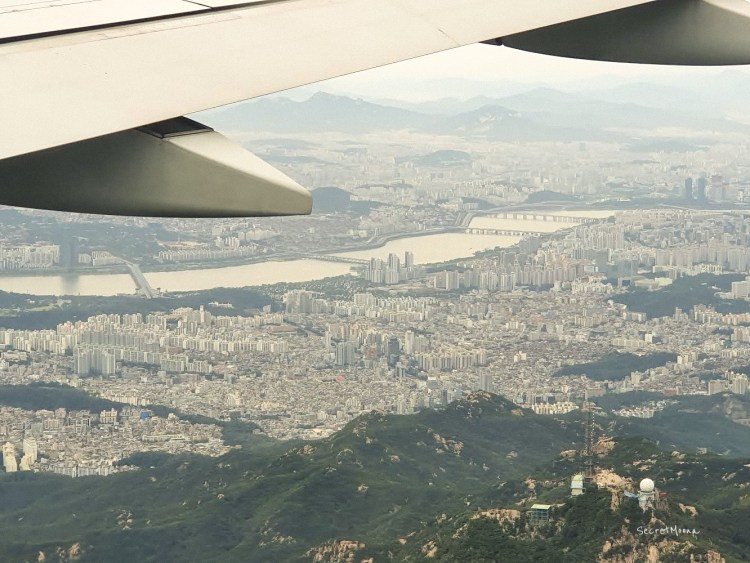 A plane flying over Busan, South Korea