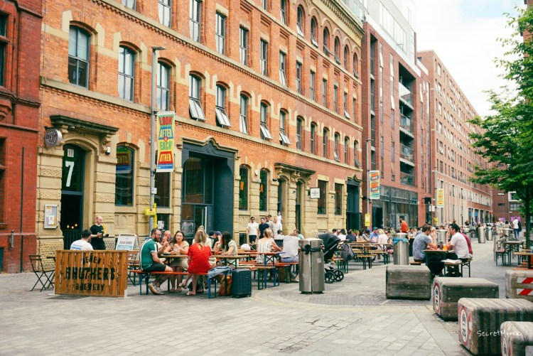 Street in Ancoats with people dining outside