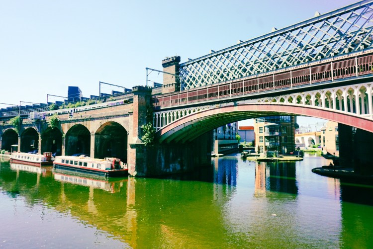 Castlefield's canal with canal boats and railway in background