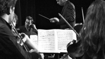 Sinfonietta musicians and conductor