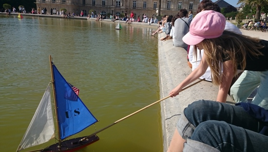 kid with toy boat