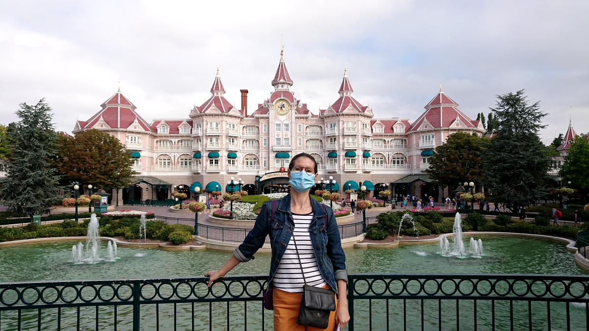 Heather in a mask at Disneyland Paris