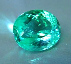 Looking pretty super, this 13.42 carat oval is a highly saturated light-medium tone green-blue hue from Mozambique