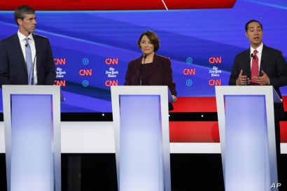 Democratic presidential candidate former Texas Rep. Beto O'Rourke, left, Sen. Amy Klobuchar, D-Minnesota, and former Housing Secretary Julian Castro participate in a Democratic presidential primary debate hosted by CNN/New York Times at Otterbein University, in Westerville, Ohio, Oct. 15, 2019.