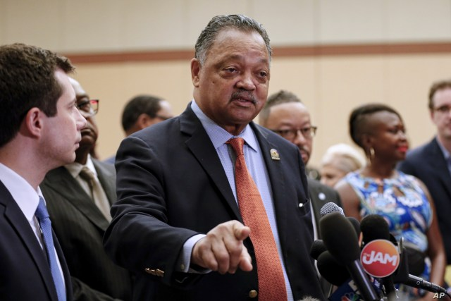 Rev. Jesse Jackson addresses reporters at the start of the Rainbow PUSH Coalition Annual International Convention in Chicago, July 2, 2019.