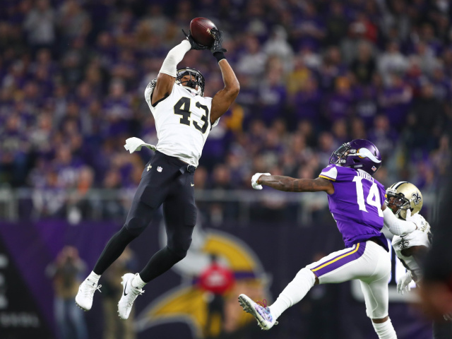 Marcus Williams soars above Stefon Diggs to make a momentum-changing interception in the divisional round playoff game. Sparking a nearly completed comeback.