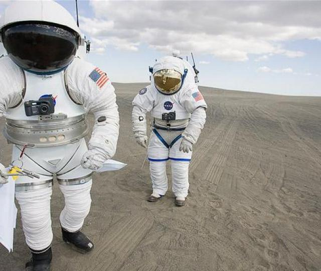 Astronauts Engineers And Scientists Wearing Prototype Spacesuits Driving Prototype Lunar Rovers And Simulating Scientific