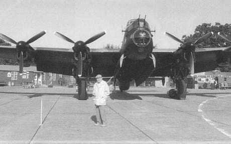 John Rowland in front of a Lancaster in 2005