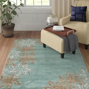 zader floral turquoise light brown area rug