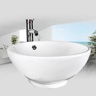 white ceramic circular vessel bathroom sink with faucet