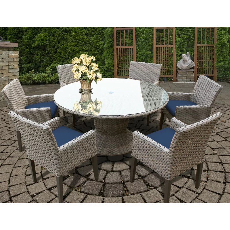 rockport round 6 person 60 long dining set with cushions