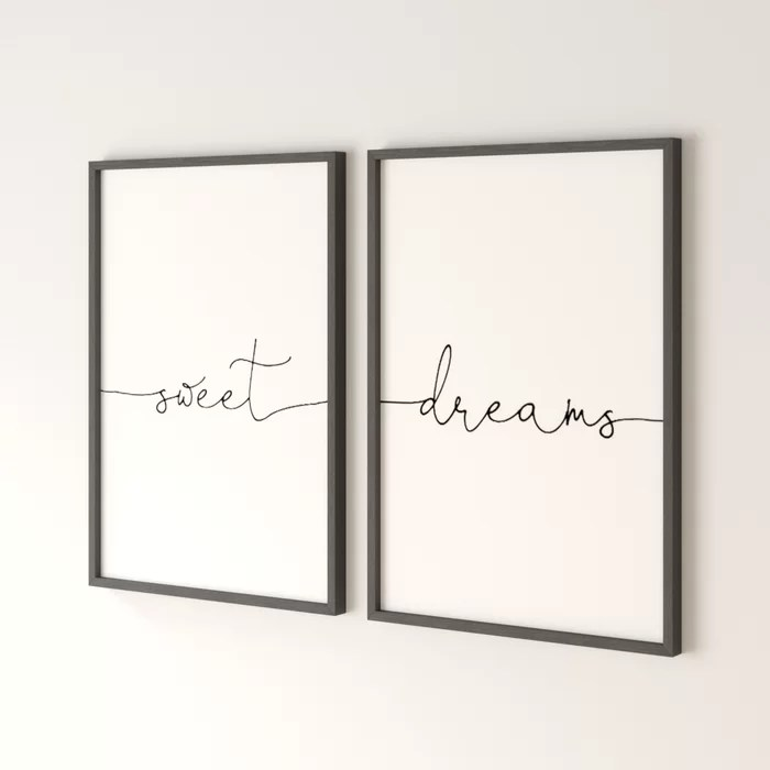 Two black frames each with a single word inside 'Sweet' and 'Dreams' written in fancy script