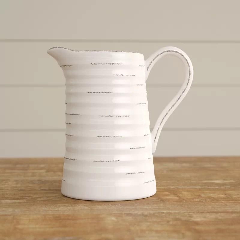 rustic white ceramic pitcher