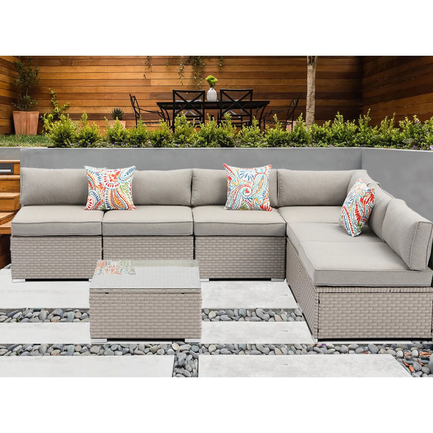 outdoor sectional 7 piece wicker sofa in warm grey w 6 pillows in psychedelic colours elegant patio furniture chair and table set for backyard