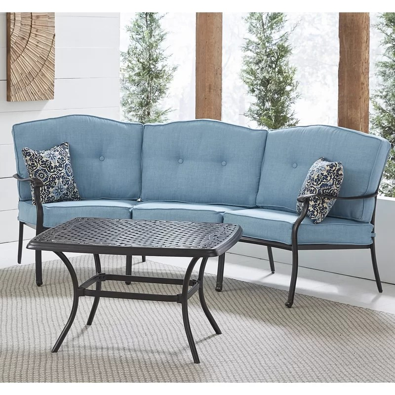 carleton 2 piece patio set with cast top coffee table and crescent sofa in blue