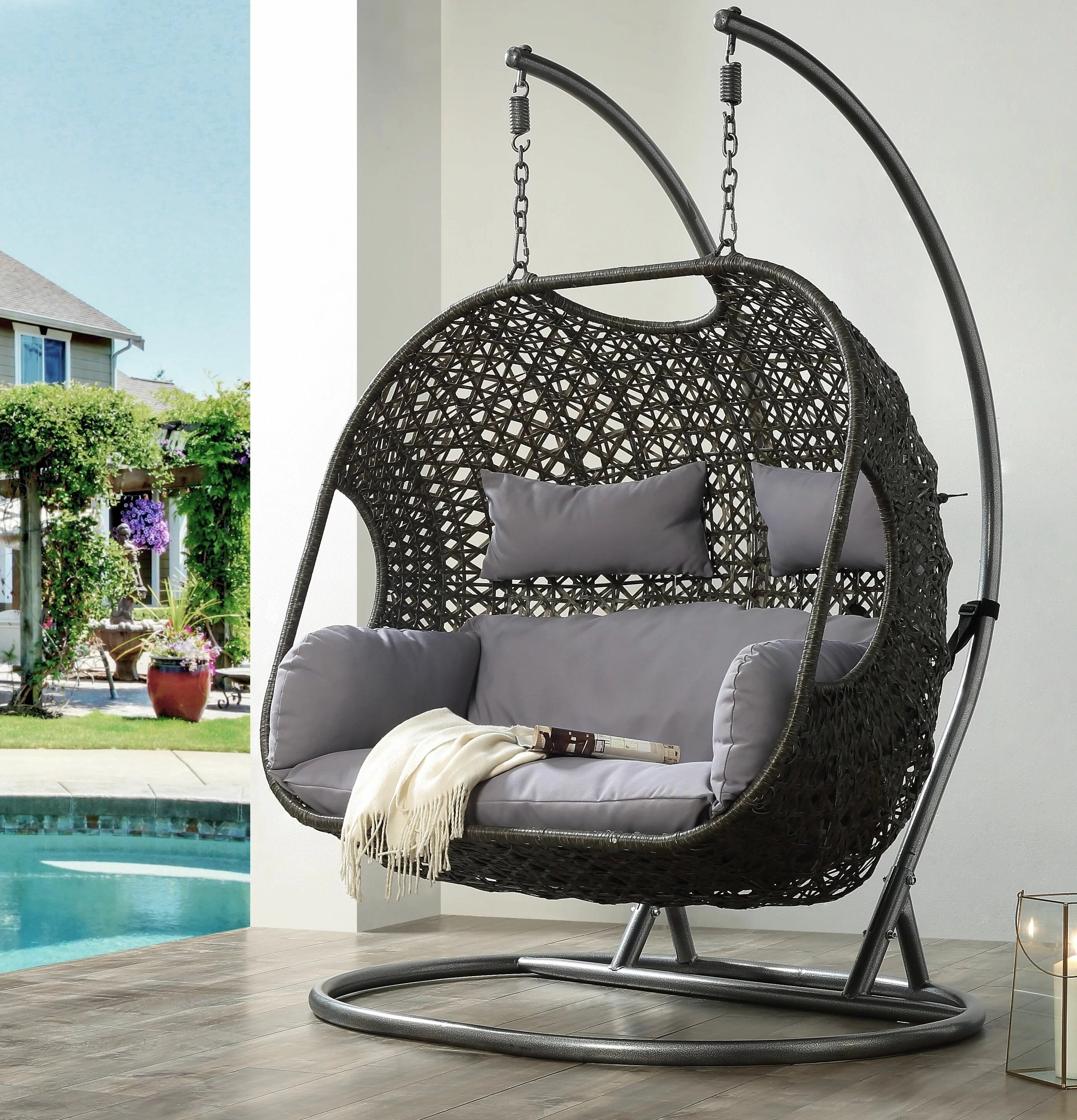 fabric and wicker patio swing chair with removable cushions
