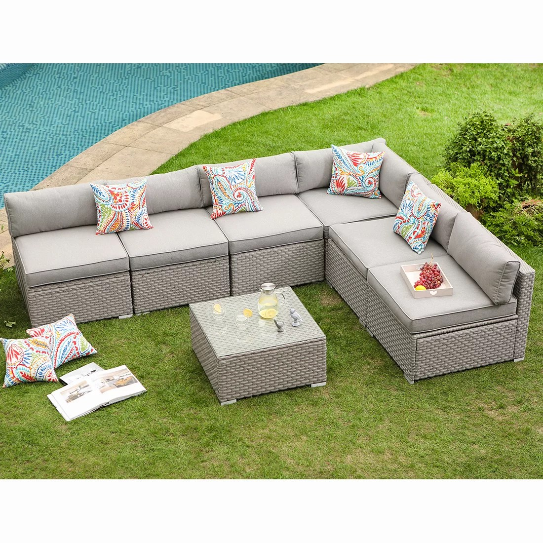 kemar 7 piece outdoor furniture set warm gray wicker sectional sofa w thick cushions glass coffee table 6 floral fantasy pillows