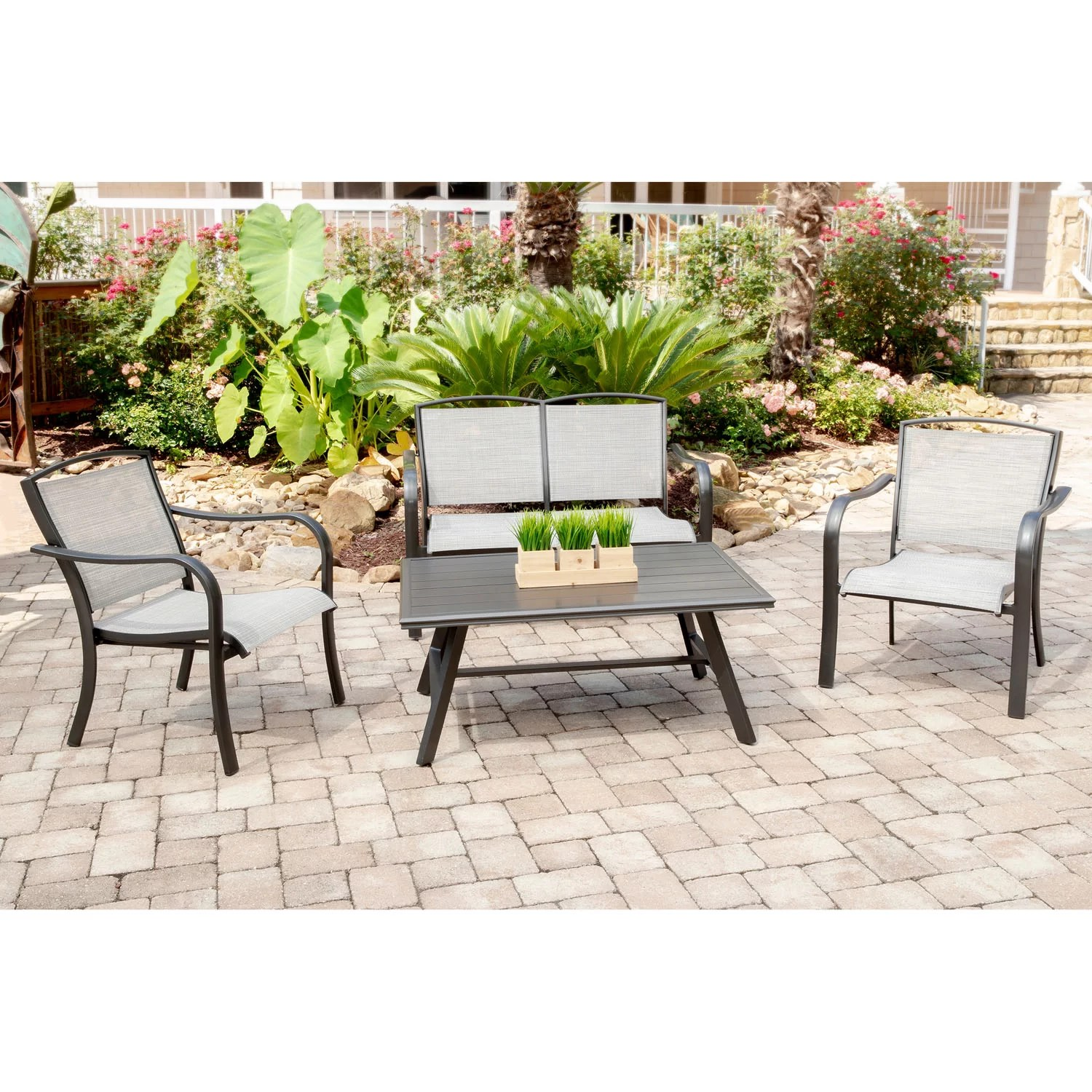 charlton home wrenn 4 piece commercial grade patio seating set with 2 sling lounge chairs sling loveseat and a slat top coffee table wayfair