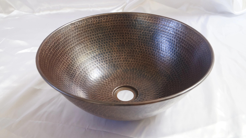 metal hand hammered circular vessel bathroom sink