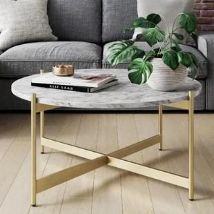 belynda cross legs coffee table