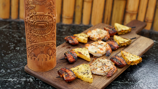 Moana Bamboo Sipper from Bengal Barbecue and Tiki Juice Bar in Disneyland Park, and Grilled Shrimp and Sausage Skewer from Bengal Barbecue
