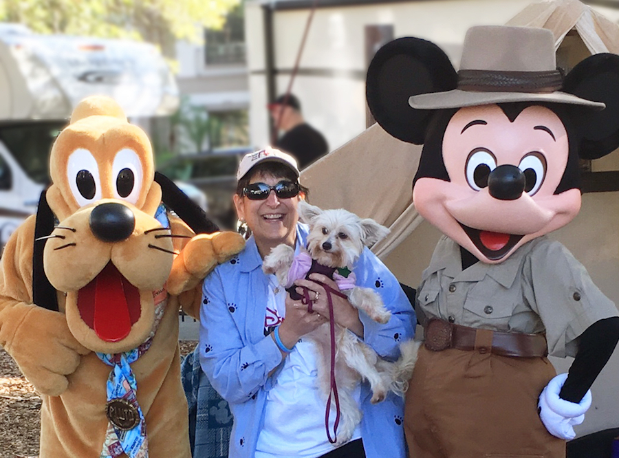 Marianne Hunnel with Sandy Sue at Paws in the Park, a community event in Orlando supported by Walt Disney Parks & Resorts