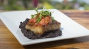 Roasted fish with black beans, salsa and cilantro