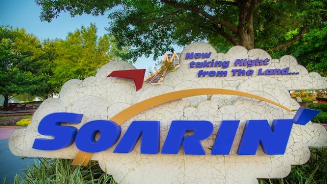 "An outdoor Soarin' sign with the phrase, ""Now taking flight from The Land…"""