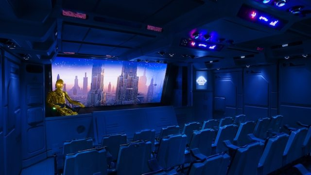 C-3PO against a city backdrop on Star Tours: The Adventures Continue