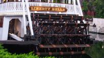 The Liberty Belle with its steam-powered paddle wheels journeys along Rivers of America