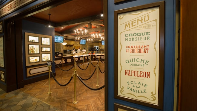 Display cases and chandeliers leading to the ordering counter at Les Halles Boulangerie & Patisserie
