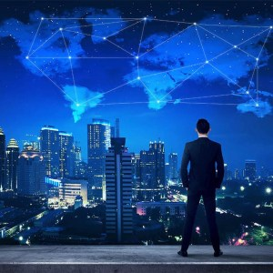 man overlooks city at night with digital world in the sky