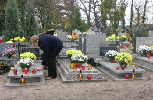 Offering candles, prayers, and flowers to departed loved ones on All Saints' Day