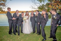 Bride posing with the groomsmen