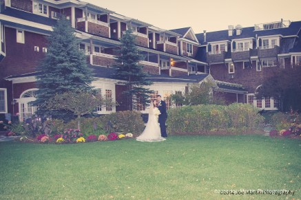Bride and groom posing Church Landing at Mill Falls