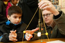 Christopher Blanchard, 8, gets help from his father Robert Blanchard during a STEM Symposium activity.