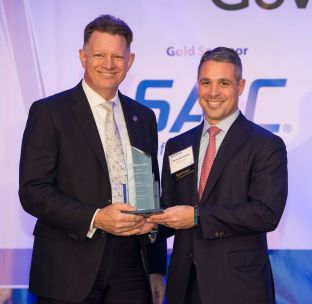 Rick Wagner, ManTech and Intelligence Executive of the Year winner and Ryan Newman, Goldman Sachs