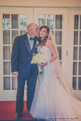 Dad gives his little girl a kiss before she walks as a bride