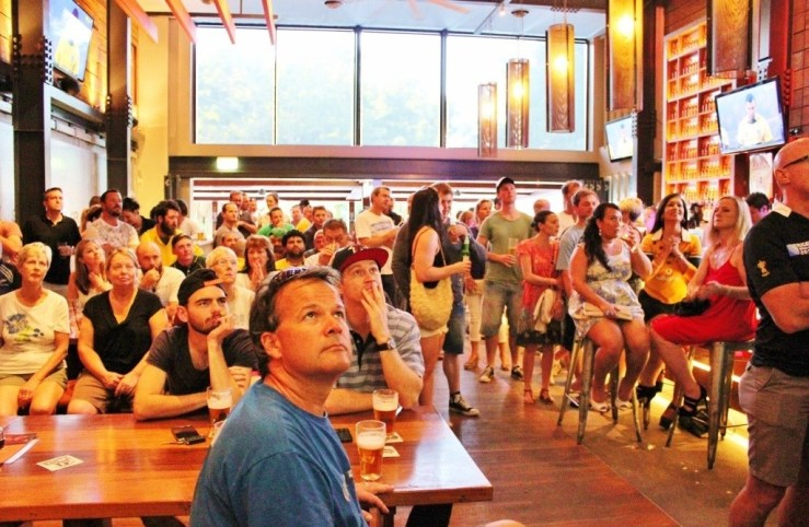 Crowded bar at happy hour in Cairns, Australia