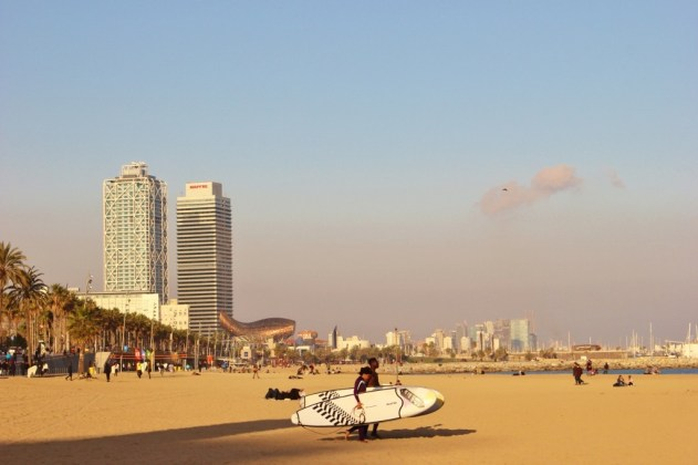 Surfers on Barceloneta Beach in Barcelona, Spain