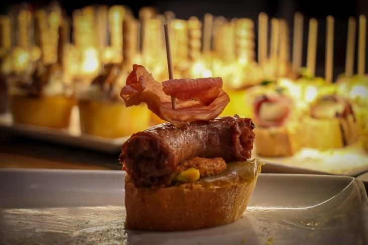 Sausage and bacon tapas at tapas bar in Barcelona, Spain