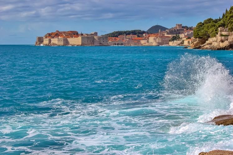 Wave crashing on rocks at secret viewpoint in Dubrovnik, Croatia