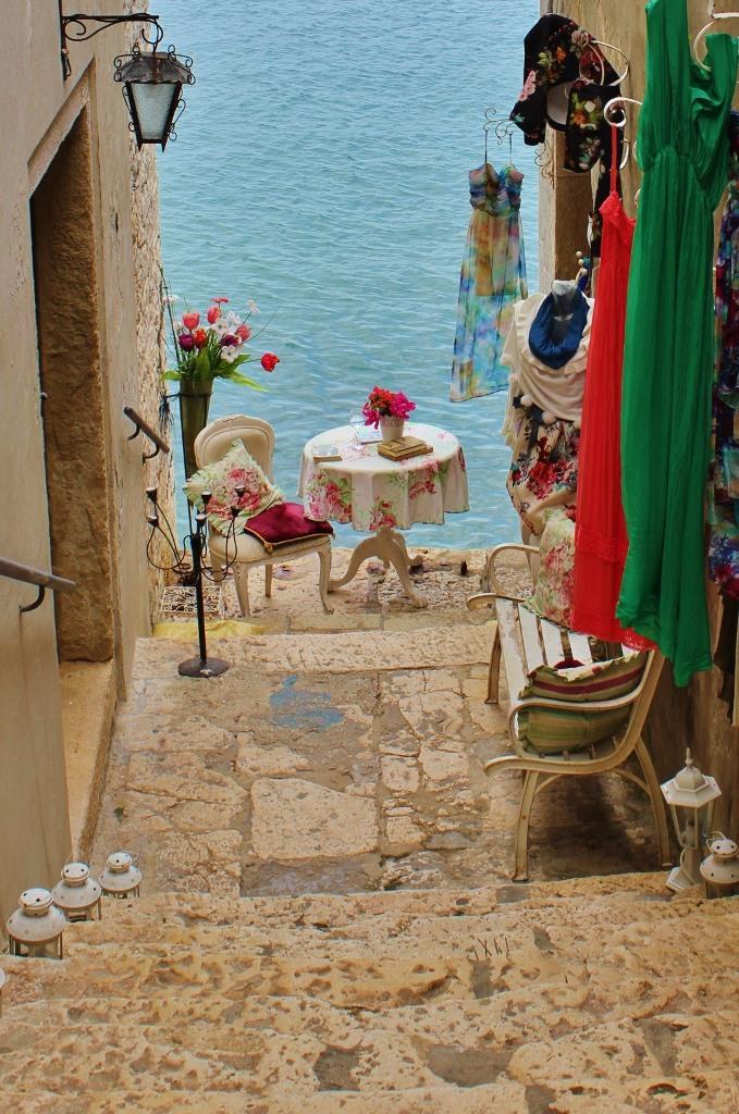 Seaside Table at end of cobblestone lane, Rovinj, Istria, Croatia