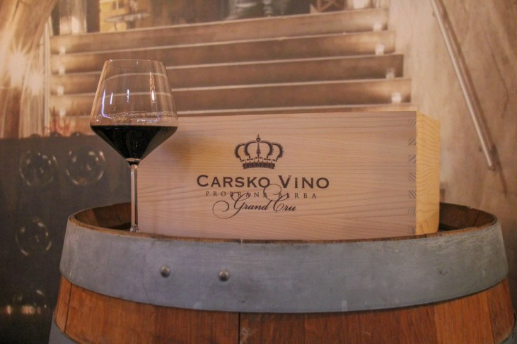 Glass of red wine on barrel at wine tasting in Mostar, Bosnia and Herzegovina