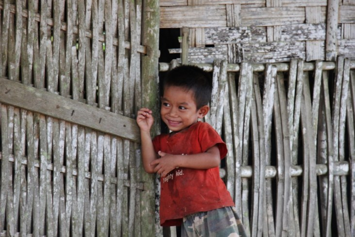 Young boy smiles for camera in Ban Houy Pha Lam village in Laos