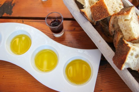 Tasting olive oils with fresh baked bread at Hora Winery in Stari Grad, Croatia